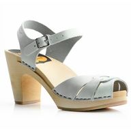 This Hasbeen model is based on a high-heeled clog from the late disco 70's. It is 3.5 inches high and really comfortable. This chrome-free model is hand-made in Sweden with genuine natural grained leather and a lime-tree wooden sole. The high-quality leather will soften and stretch with wear. The natural color is untreated and will darken slightly by sunlight, wearing beautifully. It can be treated with natural olive oil to make it more durable and to create a darker tone. www.berenshoes.com