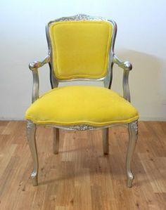 Love this bright yellow velvet Louis chair!