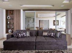 Dicas para montar sua sala de TV com dicas de especialistas para seu sofá.