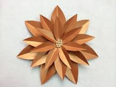 Paper flowers are ideal for scrapbooking and card making.This tutorial will show you how to make this flower. Then add some beads to the center for a little embellishment. Paper Flower Art, Paper Roses, Flower Crafts, Origami Paper, Diy Paper, Paper Crafts, Diy Crafts, Handmade Flowers, Diy Flowers