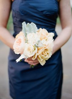 Rose and Dusty Miller Bouquet with navy bridesmaid dress. Love this color combo of peaches and navy