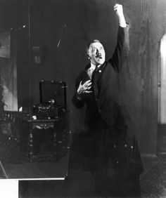 Hitler poses to a recording of his own speeches 1925