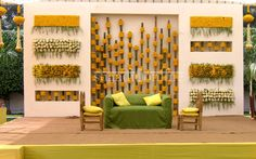 Beautiful backdrop for the reception stage! Use of yellow marigold flowers with assorted white flowers and green colored drapes for this yellow, green and white theme decor looks simply gorgeous! Backdrop Decorations, Indian Wedding Decorations, Festival Decorations, Flower Decorations, Back Garden Wedding, Flower Wall Wedding, Wedding Mandap, Wedding Stage, Desi Wedding