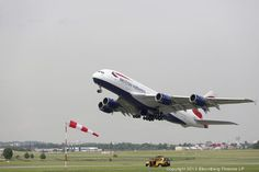An Airbus A380 aircraft, operated by British Airways, takes off ahead of participating in a flying display at the Paris Air Show.