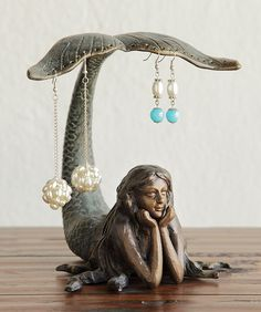 [orginial_title] – Touch of Class Mermaid Figurine Tabletop Earring Holder This dreamy Mermaid helpfully holds your earrings as you decide on the perfect outfit. This tabletop earring holder is hand-painted with a verdi patina tail. Mermaid Home Decor, Mermaid Bedroom, Mermaid Jewelry, Mermaid Art, Mermaid Mermaid, Keramik Design, Jewelry Holder, Earring Holders, Coastal Decor