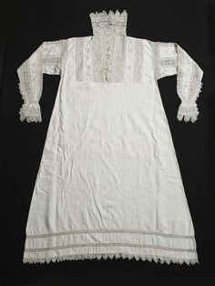 Smock | Museum of London- A woman's white linen smock decorated with intricate bands of geometric cutwork taken from another object, possibly a cover, and used as insertions on the sleeves, cuffs, collar and upper part of the front. If worn underneath an open-necked gown, the exquisite needlework would have been visible