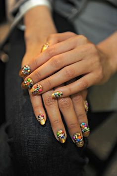 Created by Butter London global color ambassador Katie Hughes for the Libertine runway show, these nails feature a golden polish called Marbs (it'll go on sale in Summer 2013) topped with a cascade of crystals, to mirror those that appeared on the clothing.
