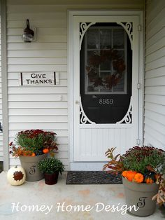 Homey Home Design: Front Porch Fall Decor. Fill pots with flowers and small pumpkins