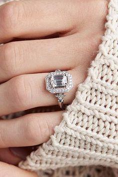 engagement ring designers white gold halo emerald cut diamond