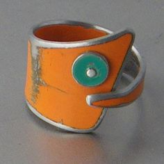 """You Got Mojo, features jewelry """"made using reclaimed metals. This fun ring was made using metal salvaged from a 60's Rambler. The orange is the original car color left intact. A great recycling program!  http://www.yougotmojo.bigcartel.com/"""