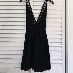 BRAND NEW black strappy dress NWOT. I bought this dress online at Nasty Gal, tried it on and wore it to a function even though it didn't fit me that great so now I'm trying to sell. I don't have enough boobs to make the top part fit right, but super cute strappy details on the front and back! Cheaper through ♏️, Reasonable offers only! Nasty Gal Dresses Mini