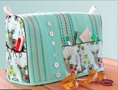 Sewing Machine Cover with Decorative Stitching Accents: It's. Sewing Machine Cover with Decorative Stitching Accents: It's National Sewing Month! If you enjoy arts and crafts you will appreciate this site! Sewing Machine Covers Covering your serger or sew Sewing Hacks, Sewing Tutorials, Sewing Crafts, Sewing Patterns, Tutorial Sewing, Sewing Tips, Serger Sewing, Tatting Patterns, Sewing Basics
