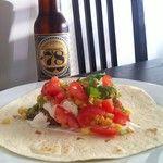 Breaded fish tacos with corn salsa, guacamole and sour cream!