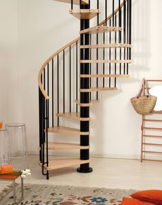 Inside Circular Staircase from Canadian Modular Stairs. Spiral and Loft Staircases, Railings, Spindles, & Balustrade products Spiral Staircase Kits, House Staircase, Staircase Design, Spiral Staircases, Stair Design, Feng Shui, Stair Bookshelf, Bookshelves, Stair Kits