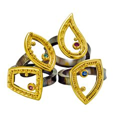 Granulated 22kt yellow gold rings are set with gemstones and have forged, oxidized sterling silver bands. By Zaffiro