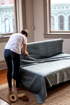 Make your own Ikea Couch in 5 Simple Steps // Ikea Hacks  We were so excited to try out this DIY Ikea Bed Hack! In just 5 simple steps you can create your own Ikea Couch out of an Ikea Bed.  We were looking all over, trying to find a couch for our studio, but we were on a tight budget so w