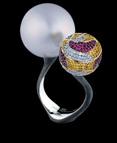 Jewellery Theatre: Jewellery Bionics Ring, 18K white gold  187 diamonds 0.55 ct D-F/VVS 269 yellow sapphires 1,17 ct 170 rubbies 0.69 ct 1 white pearl 19.0 mm
