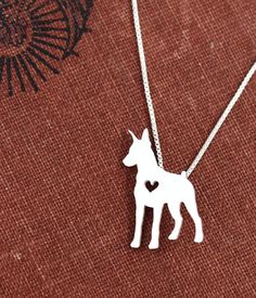 My mom bought me this! I love it! Doberman Pinscher necklace, sterling silver hand cut pendant, with heart, tiny dog breed jewelry on Etsy, $45.00