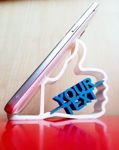 Like Shaped Phone Holder with custom text option - printed product. You can order any other personalised cool printed phone stand with personal texts and figures at Manubim. Cell Phone Stand, 3d Prints, Phone Holder, The Help, Texts, Custom Design, Printed, Cool Stuff, Creative