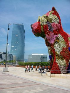 "Jeff Koons' ""Puppy"" near Guggenheim Museum by EEPaul, via Flickr"