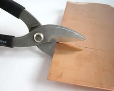 Cutting copper sheet with tin snips, making copper bangle