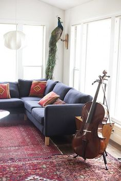 Image result for dark gray couch with persian rug modern #RedRugs