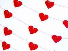 Red Paper Heart Garland - Photo Booth Prop - Valentines Day - Wedding Decoration. $10.00, via Etsy.
