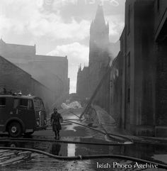 A fire at Powers Distillery, John's Lane, Dublin. The fire fortunately occurred during a period when the distillery was not in use, but a warehouse containing 4000 hogsheads of maturing whiskey was destroyed. Picture shows Firemen and fire engine with John's Lane Church in the background. 5 July 1961 Old Pictures, Old Photos, Dublin City, Firemen, Fire Engine, Distillery, Picture Show, Warehouse, Whiskey