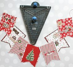 Creating banners with the We R Memory Keepers Banner Punch Board is so easy and fun. Create this cute banner with Photo Play Paper's Dear Santa paper.