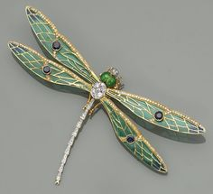 An enamel, diamond, sapphire and eighteen karat gold dragonfly brooch -  the plique-à-jour enamel wings accented by circular-cut sapphires and single-cut diamonds, with a round brilliant and single-cut body, completed by enamel eyes; signed HW. | © Bonhams 2001-2015