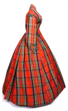 Plaid perhaps?  Beautiful Plaid Day Dress, 1860s - Plaid wool day dress trimmed in green soutache, with green buttons at center front. An excellent example of the stylishness of plaid during the mid-19th century. Bodice fully boned.