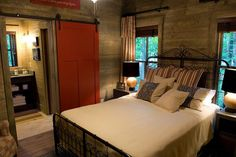Craftsman style rustic cabin bedroom with a hint of vivacious red [Design: Pine Mountain Builders]