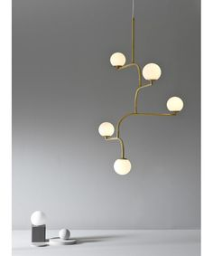 Mobil is build up by four equal parts linked to each other. Together they create a pendant lamp with graphic qualities and movement that looks interesting from all angles. Lounge Lighting, Cool Lighting, Interior Lighting, Modern Lighting, Lighting Design, Pendant Lighting, Lighting Stores, Pendant Lamps, Industrial Lighting