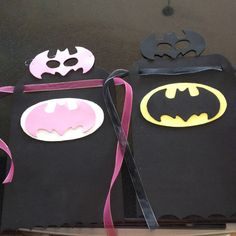 An idea I came up for the little boy I nanny for's birthday batman birthday party... All made out of foam and then they can glue it together and decorate with foam paint or stickers :) the pink ones are for the little sisters of the boys that have to attend :) sheer ribbon is used to tie around to wear the cape