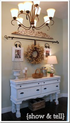 dresser turned entry table. love the curtain rod to hang a wreath. Could change it seasonally.