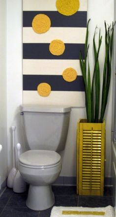 Never thought about doing a gray toilet in the hall bath! Perfect! Love the plant holder out of shutters too!