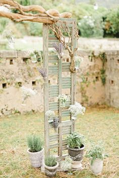 rustic diy wood and branches wedding alter ceremony backdrop