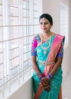 South Indian bride. Gold Indian bridal jewelry.Temple jewelry. Jhumkis. Teal blue and pink silk kanchipuram sari.braid with fresh jasmine flowers. Tamil bride. Telugu bride. Kannada bride. Hindu bride. Malayalee bride.Kerala bride.South Indian wedding.