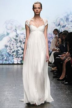 An ethereal creation from Monique Lhuillier with a gorgeous cap-sleeve detail.