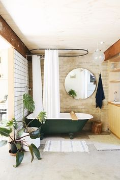 Chic Brick Bathroom Design With A Retro Green Bathtub