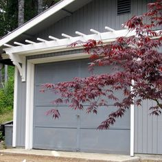 blue roof cabin: DIY Trellis Over the Garage Door