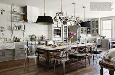 love the farmhouse, sink, mix of chairs at island & all the touches of antique/vintage silver used