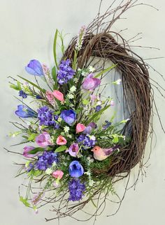 """Spring Wreath, Summer Wreath, Tulip Wreath, Bird Wreath, Spring Decor, Pastel Wreath, Crocus, Hyacinth, Bird, Birch Wreath, Oval Wreath  Greet the upcoming season with this stunning new floral design from Crooked Tree Creations. Assembled on a 18"""" handmade wispy oval birch base you will find a sweet pink bird with a trio of eggs perched upon her nest. Lush seasonal greenery and a beautiful assortment of crocus, hyacinth, tulips and wildflower accents in rich pastel shades of lavender…"""