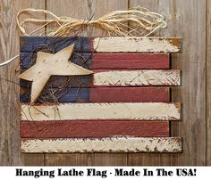 Hanging Lath Flag - Our patriotic Hanging Lath Flag is made from painted, distressed wood with vine and raffia accents. It has a metal hanger. Show off your patriotic side with this adorable, country accent. Flags With Stars, Kp Creek Gifts, Flag Signs, Wood Stars, Red Wagon, Metal Hangers, Switch Plate Covers, How To Distress Wood, Colorful Decor