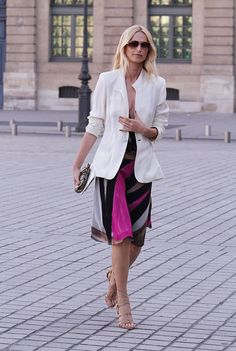 White blazer over colourful dress