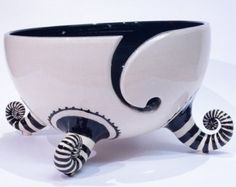 Black and white yarn bowl with stripey socks