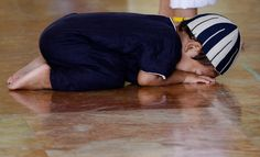 A Muslim boy attends a prayer session in celebration of the Eid al-Adha festival inside the Golden Mosque in Manila.