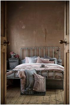 Cool idea. Looks like the bed frame is made from galvanized pipe. Now that is really industrial!: