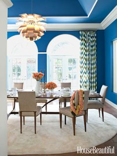 A bright blue dining room.