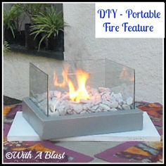 portable mini fire feature, diy, outdoor living, A few pieces of leftover planks some glass mesh wire a can and you end up with this lovely piece